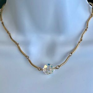 Gold tone necklace with AB crystal